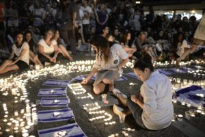 Israelis light candles in Tel Aviv's Rabin Square on Monday as they mourn the news of the death of three abducted Jewish teenagers. Israeli forces found the bodies of the three missing teenagers on Monday after a nearly three-week-long search. Credit: Tomer Neuberg/Flash90.